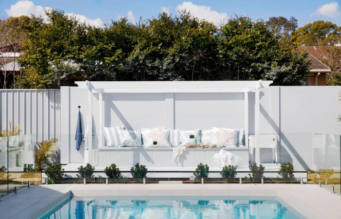 Create a poolside oasis like this Hamptons-style retreat by Three Birds Renovations. House 11.