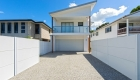 SlimWall fence with expressed join perfectly complements weatherboard cladding | ModularWalls
