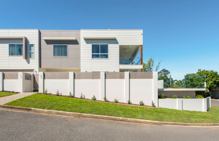 Sloping Block Landscaping - Integrated Retaining & Fencing | ModularWalls