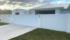 Coastal Barn Dream Home - Driveway Entry with EstateWall