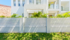 EstateWall front fence with white slats and textured paint