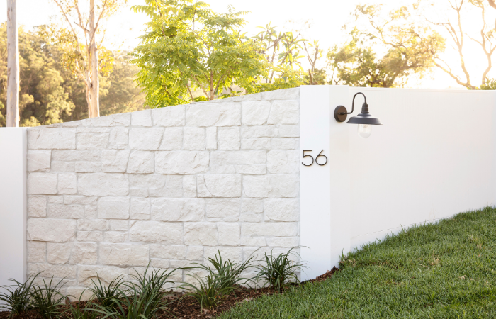 Three Birds Renovations - House 13. House entry featuring EstateWall with stone cladding