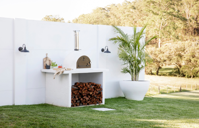 Three Birds Renovations House 13 - Outdoor Pizza Oven with EstateWall feature wall