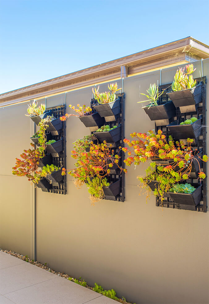 SlimWall with mounted planter boxes