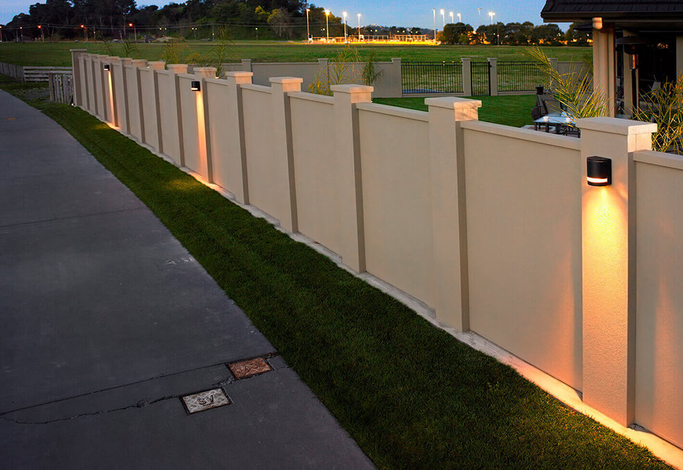 Driveway boundary wall with integrated post lighting