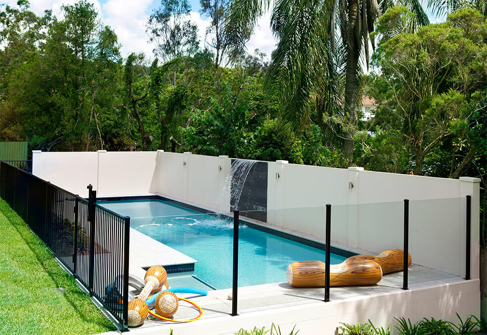 Pool wall with custom water feature and integrated lighting