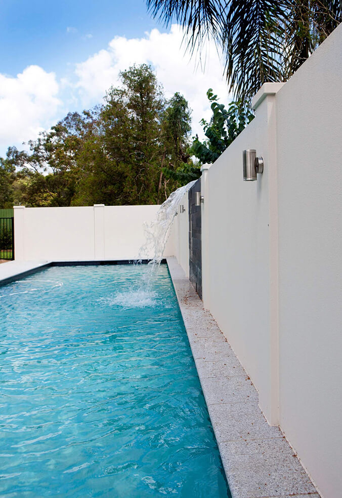 Pool EstateWall with custom water feature and integrated lighting