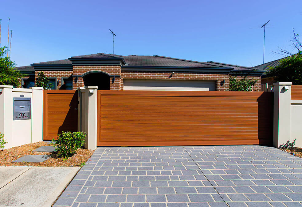 Front EstateWall with external capping and custom driveway gate