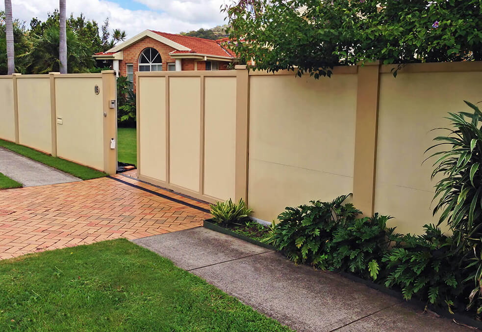 Front VogueWall with external capping and solid panel driveway gate