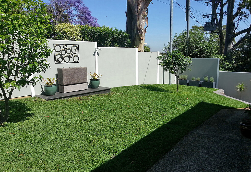 Sloped backyard premium fencing with hanging wall art