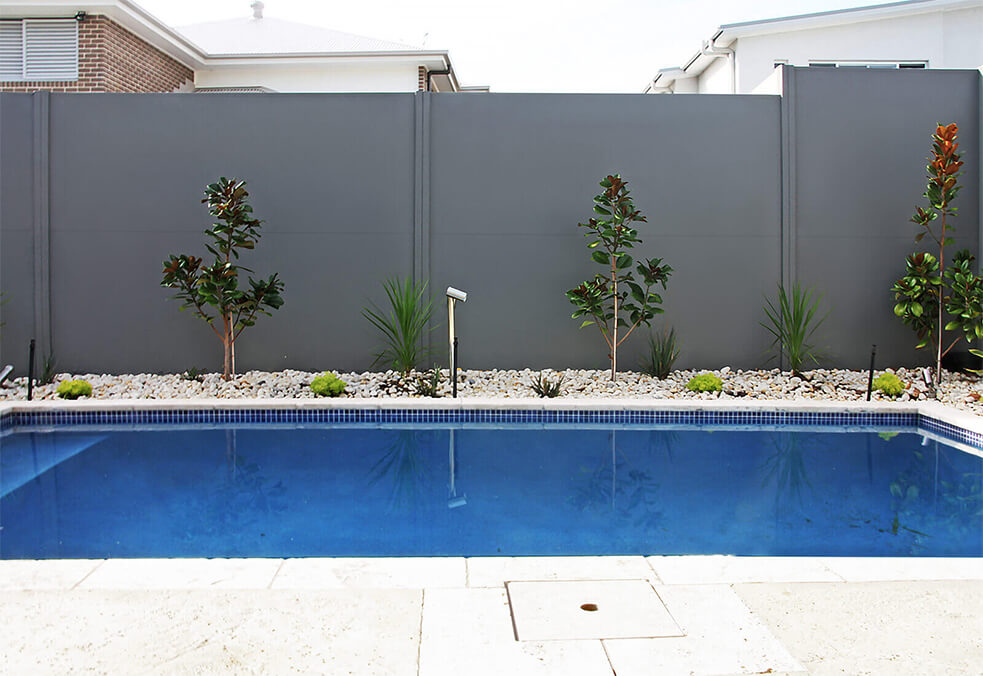 Pool wall offering privacy and integrated retaining