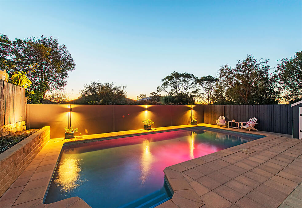 Pool wall with post integrated lighting