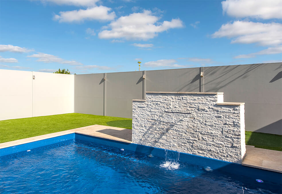 Pool wall with integrated post lighting