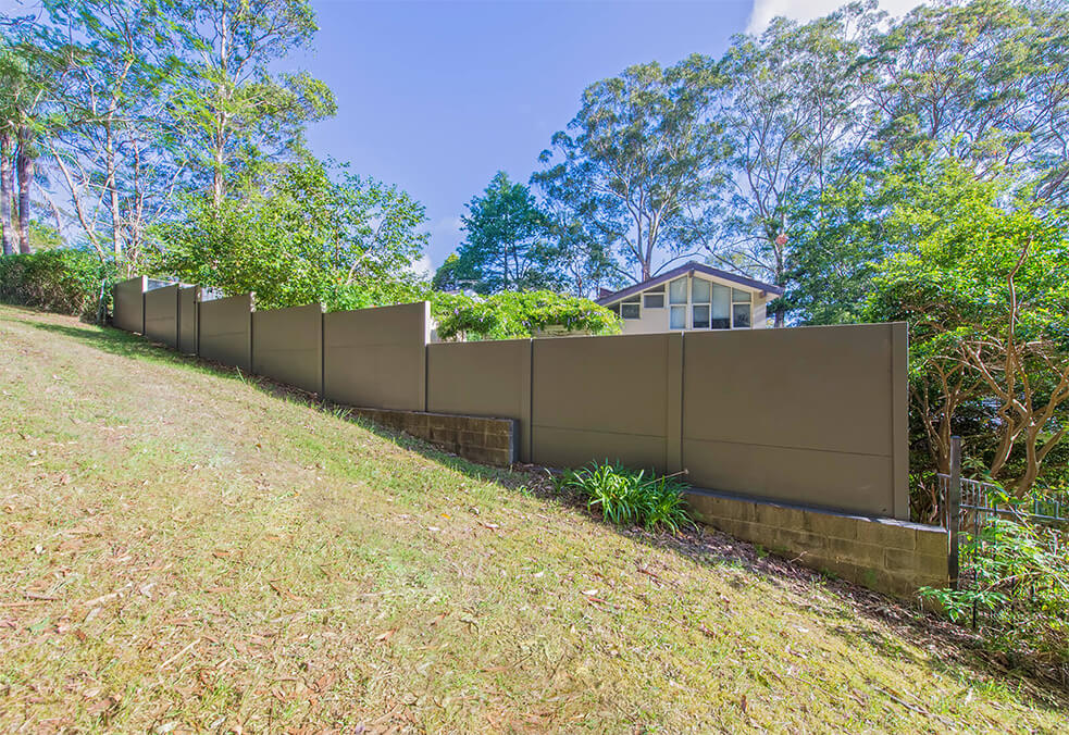 Rear boundary wall on sloping block
