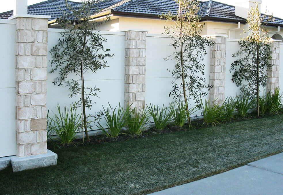 Boundary wall with stone cladded posts