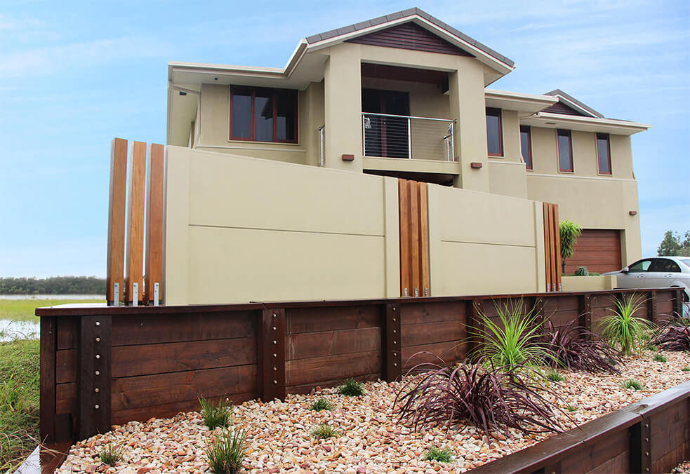 Front wall with flush capping and custom vertical timber infills