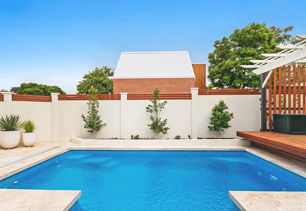 Full boundary wall for pool entertaining area