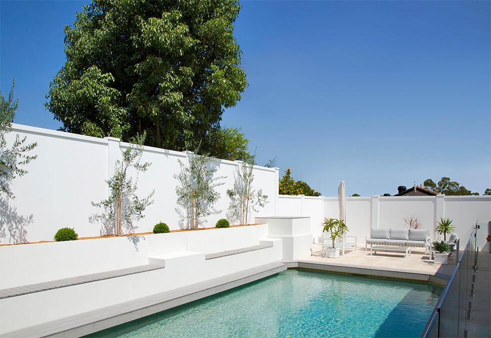 Pool oasis within full boundary wall