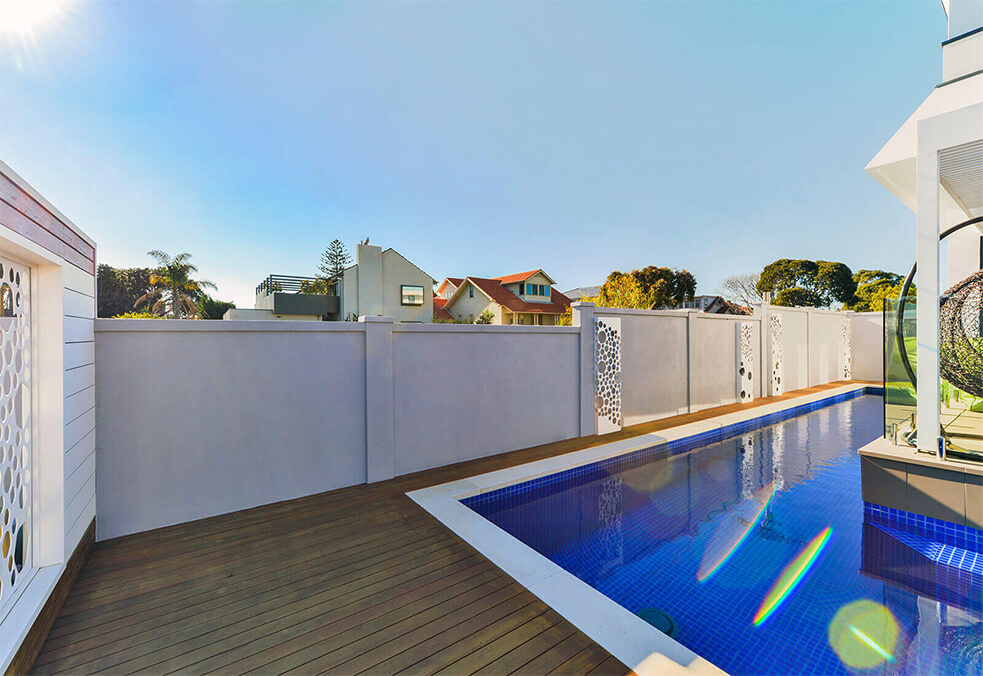 Pool wall with external capping and laser cut features